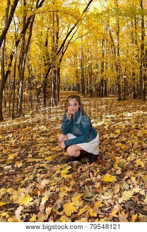 Young Female Kneeling On Forest Trail
