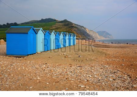 Blue beach huts Charmouth Dorset England UK overlooking Lyme Bay and on the South West coast path