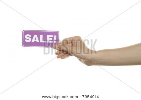 Ð¡ard with the text Sale in a woman's hand