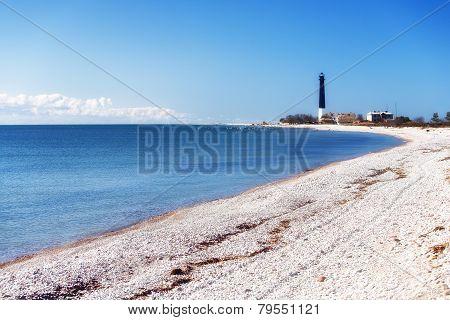 Black Beacon Blue Sea And White Stones