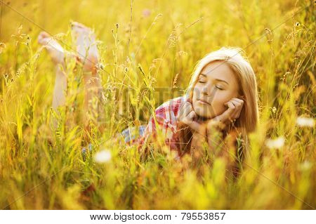 Happy Girl Lying In Grass