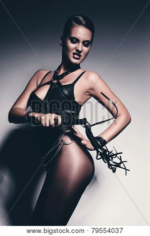 Bdsm Woman Beating Herself With Flogger