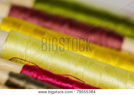 Colorful Sewing Thread Pattern. Colorful Miniature Bobbins Of Thread For Sewing