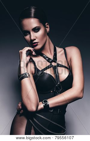 Sexy Woman In Leather Bandage
