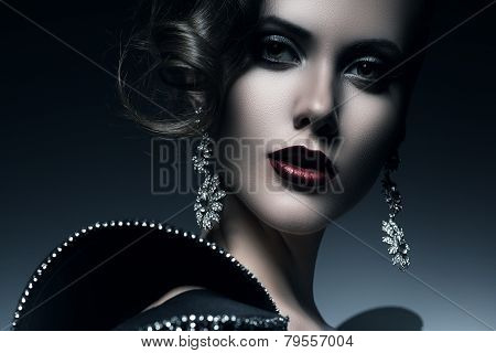 Cold Beautiful Elegant Woman With Red Lips
