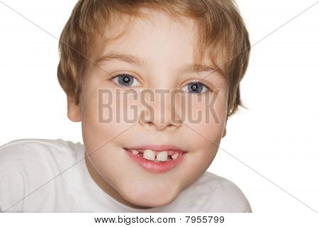 portrait small child in a white t-shirt photography studio smiling