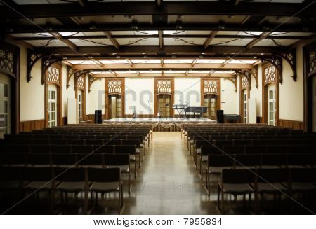 hall with benches and stage before musical performance