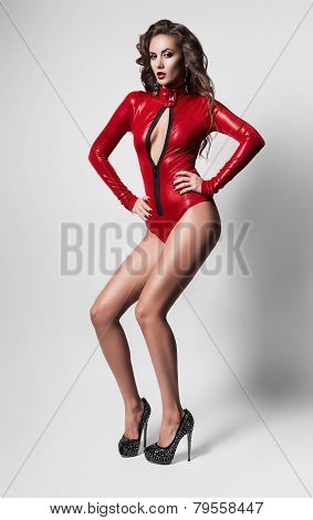 Sexy Woman In Red Costume With Decollete