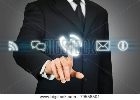 Businessman Clicking On Call Icon.