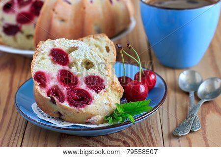 Sponge Cake With Cherries On The Blue Plate