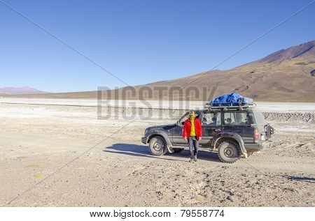SALAR DE UYUNI, BOLIVIA, MAY 16, 2014: Tourists take part in organized touristic circuit tour visiting the salt flats