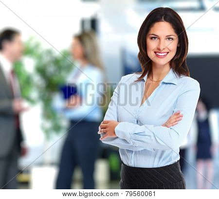 Portrait of happy young business woman over office background