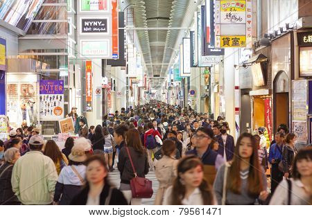 Tourists Visiting Shinsaibashi Shopping Street In Dotonbori At Night
