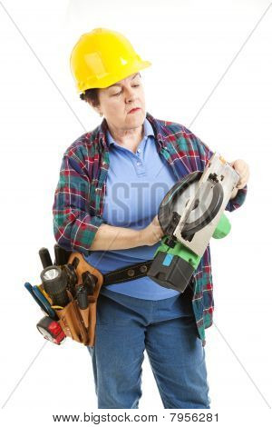 Female Worker Repairs Saw