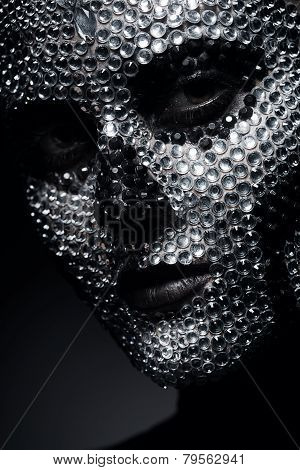 Creative Woman In Rhinestones With Skull Face
