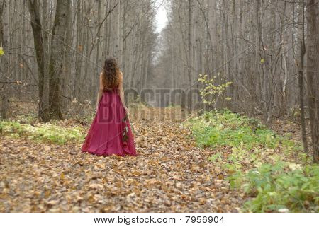 Female walking in the forest
