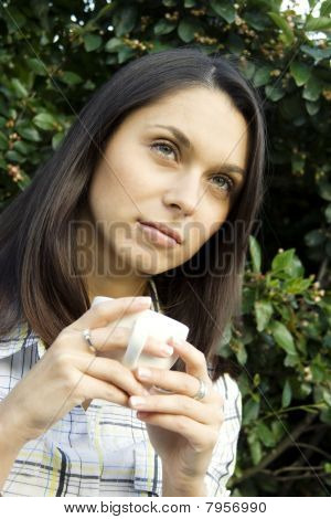Teen drinking coffee
