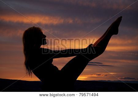 Silhouette Of Woman Sitting Legs Up Hand On Knees
