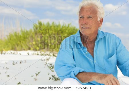 Outdoor Portrait Of A Handsome Senior Man At Beach