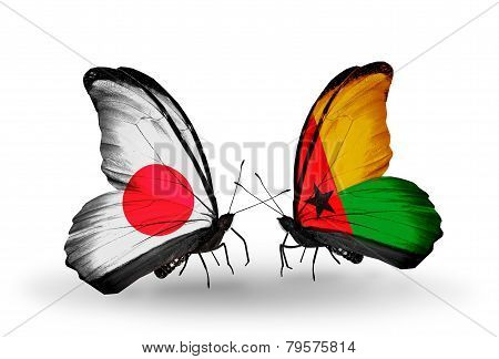 Two Butterflies With Flags On Wings As Symbol Of Relations Japan And Guinea Bissau