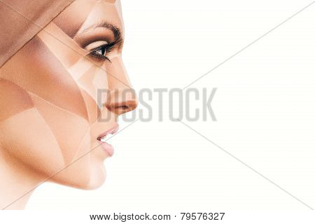 Attractive Woman With Bodyart On Face