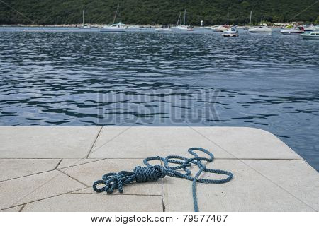 Rope of marina mooring.