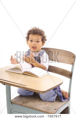 happy toddler reading a book