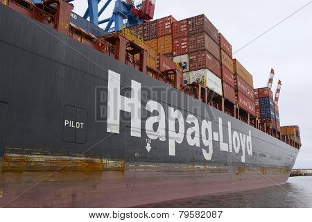 Cargo ship loaded with containers in Valparaiso port, Chile.