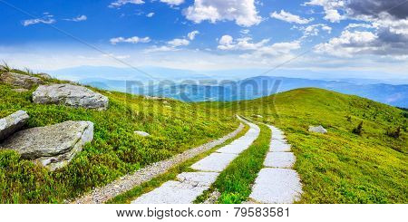 Road On A Hillside Near Mountain Peak