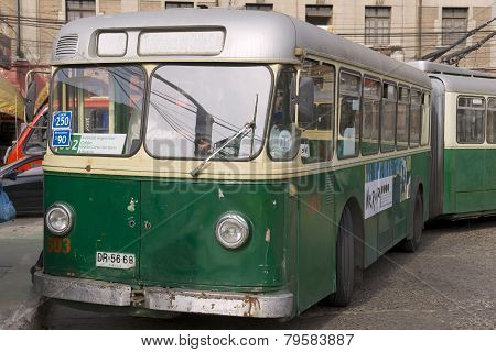 Man enters old trolleybus in Valparaiso, Chile