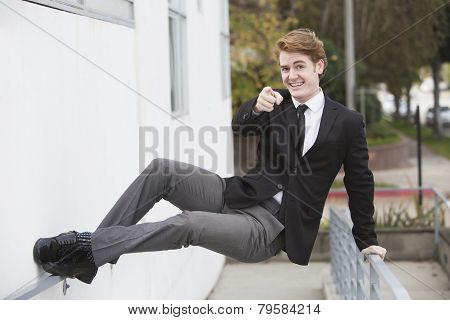 Man In Suit Jumping On A Wall