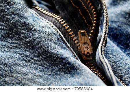 Detail of denim zipper on old worn jeans