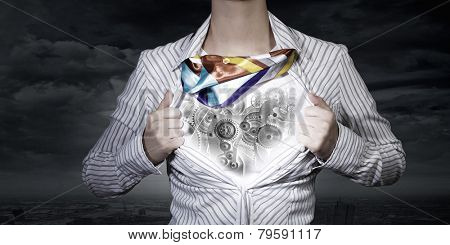 Unrecognizable businesswoman opening her shirt like superhero
