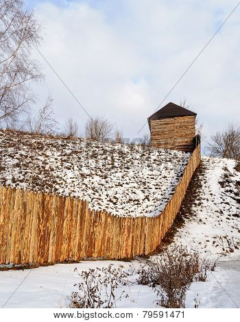 Rough Wooden Fence On The Hill In Winter Time