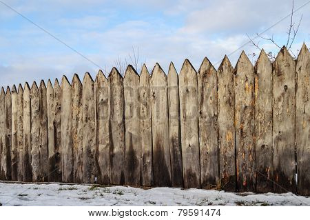 Old Wooden Fence In The Village, Winter Time