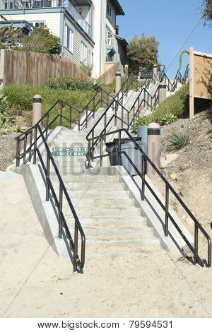 A long stairway leads from the beach cove up to the main street in a Laguna Beach California oceanfront getaway.