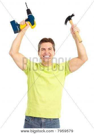Man With Cordless Drill And Hammer