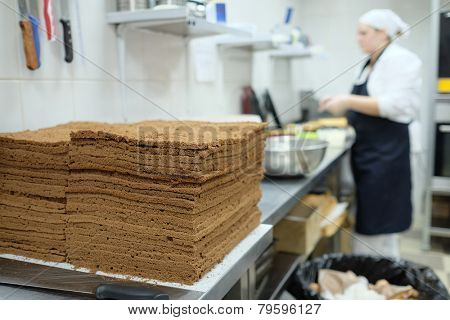 Empty chocolate shortcakes lay on the metal table. ��¡ulinary workshop