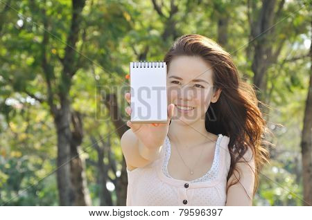 Girl Is Showing Blank Paper