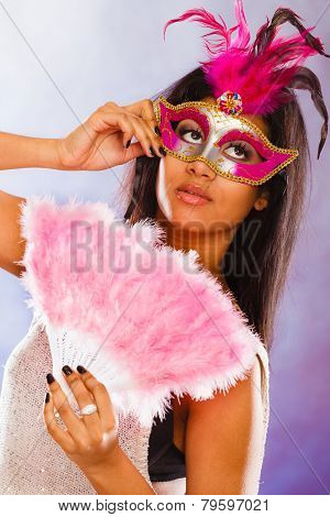 Woman With Carnival Masks Holds Fan