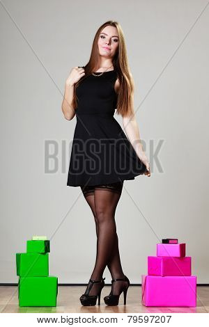 Elegant Woman With Many Gift Boxes