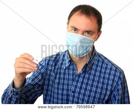Man in a medical mask with a thermometer.