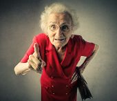 stock photo of stiff  - Grandma pointing out - JPG