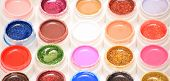 stock photo of gels  - uv nail gel container filled with paint - JPG