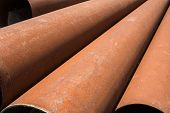 picture of orifice  - Rusty metal pipes stack on the construction site - JPG