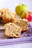 stock photo of buttermilk  - Apple buttermilk muffins with coconut crumble on napkin - JPG
