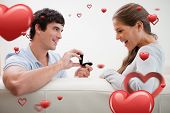 stock photo of propose  - Man making a proposal to his girlfriend against love heart pattern - JPG
