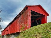 stock photo of covered bridge  - The historic Houck Covered Bridge built in 1880 crosses Big Walnut Creek in rural Putnam County Indiana - JPG