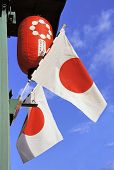 stock photo of japanese flag  - Japanese flags and Japanese lampion agianst clear blue sky - JPG
