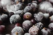 stock photo of frozen food  - frozen berries blackcurrant closeup fruit background.health and diet food. selective focus ** Note: Shallow depth of field - JPG